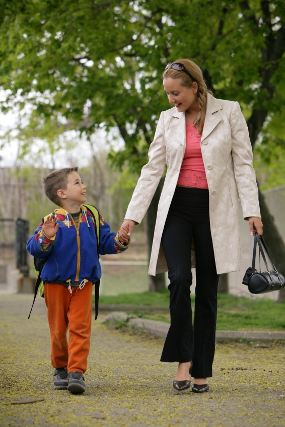 Parent and son walking from school-usp-
